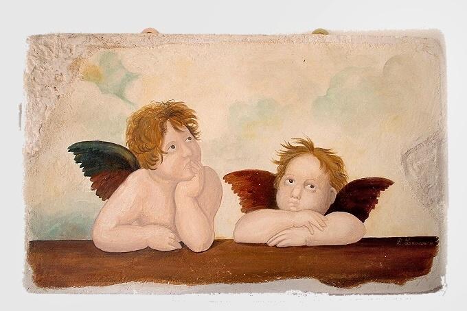 Quadro con riproduzione degli angeli di Raffaello
